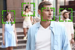 Free Facial Recognition System Identifying People On City Street Royalty Free Stock Images - 196498789