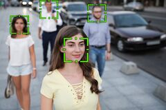 Free Facial Recognition System Identifying People On City Street Stock Photo - 197332330