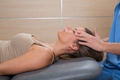 Facial reflexology doctor hands in woman face Stock Photo