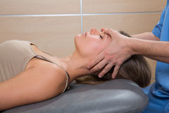 Facial reflexology doctor hands in woman face Royalty Free Stock Image