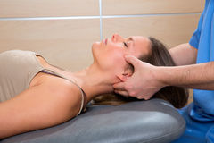 Facial reflexology doctor hands in woman face. Therapy profile view Stock Photos