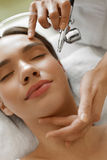 Facial Skincare. Woman Receiving Oxygen Peeling Beauty Treatment. Facial Skin Care. Closeup Of Beautiful Woman Receiving Face Oxygen Peeling At Cosmetology stock photos