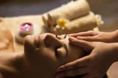 Facial SPA massage. Beautiful woman getting spa treatment. Facial massage Royalty Free Stock Image
