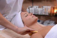 Facial sponges. Facial treatment with sponges at the spa Stock Photo