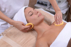 Facial sponges. Facial treatment with sponges at the spa Stock Images
