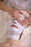 Facial Therapy. A woman received a facial massage and skincare treatment at a resort spa stock image