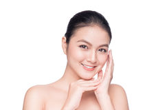 Facial treatment. Beautiful Young Asian Woman with Clean Fresh S. Kin touch her face stock images