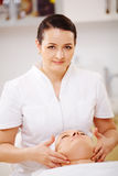 Facial treatment with massage therapist during Stock Photos