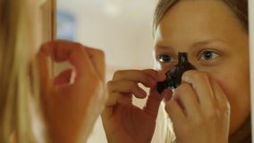 Facial Treatment. Teen girl cleaning pores of her nose with a mud mask. 4K UHD. stock footage