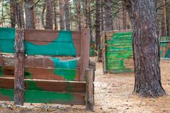 Facilities for playing paintball in the autumn forest royalty free stock photo