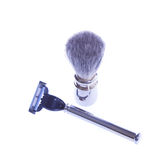 Facilities for shaving. Razor and shaving brush made ​​of metal. on a white background Royalty Free Stock Photography