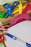 Facilities for students. Notebooks, pencils and other stationery items are on the table Stock Photography