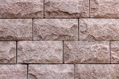 Facing bricks dirty pink color close up. Ragged Stone Texture. Stock Images