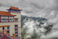 Facing East. An image of an oriental temple on a mountain top royalty free stock images
