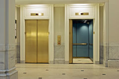 Facing elevators Stock Image