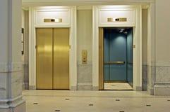 Facing elevators stock image
