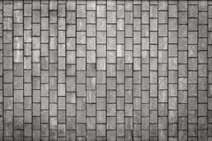 Facing gray tiles as a vintage background Stock Images