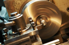 Facing metal blank by cutter on lathe Stock Photography