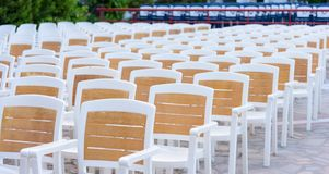 Facing a number of seats in the concert hall in the open air Stock Photos
