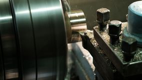 Facing operation of a brass blank on turning machine with cutting tool. Old turning lathe machine in turning workshop stock photos