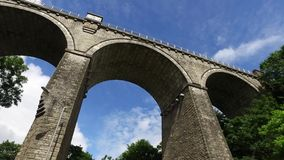Facing upward perspective of driving under tall Cornwall Railway bridge in Newquay. Facing upward perspective of driving under tall Cornwall Railway bridge in stock video footage