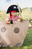 Facing view of boy dressing up as pirate Royalty Free Stock Image