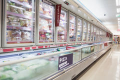 Facing view of frozen aisle. In grocery store stock images