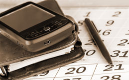 fack för planner för kalenderpdapenna Arkivfoton