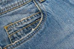 Fack p? jeans arkivfoton