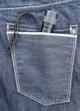 Fackel in der Jeanstasche Lizenzfreies Stockbild