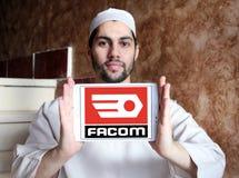 FACOM tools company logo. Logo of FACOM tools company on samsung tablet holded by arab muslim man Stock Photography
