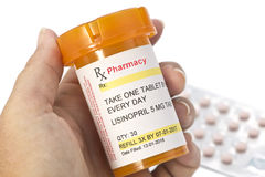 Facsimile Lisinopril Prescription. Lisinopril prescription bottle and blister pack. Lisinopril is a generic medication name, label created by photographer stock photo