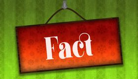 FACT text on hanging orange board. Green striped wallpaper background. Stock Photo