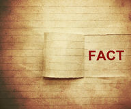 Fact. Word fact on the paper in vintage style Stock Photography
