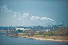 Factories in industrial port Royalty Free Stock Images