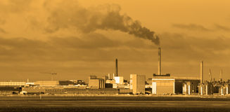 Factories and pollution. Factories causing pollution - warm tones indicate toxic gases Stock Photography
