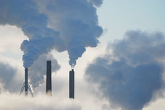 Factories steam and clouds. Steam, smog and clouds at the same time Stock Photography