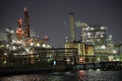 Factories view from a canal at night in Kawasaki, Tokyo. It has become quite popular in Japan to watch factories from a canal at night Royalty Free Stock Images