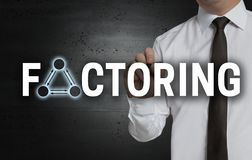 Factoring is written by businessman on screen royalty free stock images