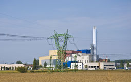 Factory. In the midst of agricultural crops Stock Images