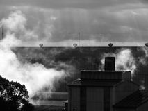 Factory. Cloudy day, suddenly down sunshine over a factory Royalty Free Stock Photo