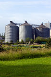 Factory. Three large cylinder shaped buildings Stock Photo