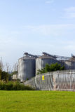 Factory. Three large cylinder shaped buildings Stock Images