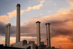 Factory. Chimneys in the sunset royalty free stock photos