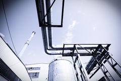 Factory. Toned photo on the blue sky Royalty Free Stock Images