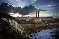 The factory. Factory in the shore of the sea illuminated by the last beams of the day Stock Photography