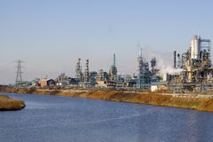 Factory 9. A view of a chemical factory by a river Stock Photos