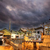 Factory of abandonment. With dramatic cloud in sky Royalty Free Stock Photography