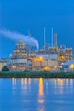Factory along river bank. Small part of a complex chemical production facility along a river bank Royalty Free Stock Images