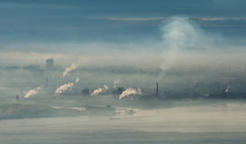 Factory area with smoke and steam. Coming out from chimney royalty free stock photos